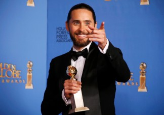 "Jared Leto poses backstage with his award for Best Supporting Actor in a Motion Picture for his role in ""The Dallas Buyers Club"" at the 71st annual Golden Globe Awards in Beverly Hills"