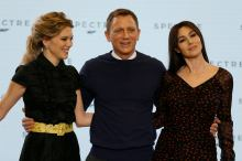 "Actors Lea Seydoux, Daniel Craig and Monica Bellucci pose on stage during an event to mark the start of production for the new James Bond film ""Spectre"", at Pinewood Studios"